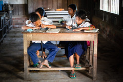 Learning Khmer (Lil [Kristen Elsby]) Tags: travel school topf25 education cambodia southeastasia khmer classroom learning editorial canon50f14 schoolchildren lesson language topv11111 primaryschool battambang 5014 travelphotography 50f14 khmerlanguage canon5dmarkii