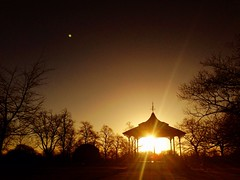 Bandstand sunset (Rob Emes) Tags: park city sunset london silhouette greenwich flare 365 iphone greenwichpark 365project iphone5 iphoneography greenwichparkbandstand 3652013 uploaded:by=flickrmobile flickriosapp:filter=nofilter dec2013