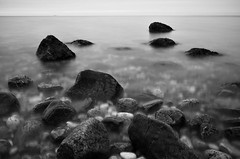 Black and White Rocks (justinababcock) Tags: winter sunset bw beach water landscape nikon rocks d7000