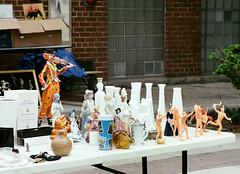 Clown Violinist (Georgie_grrl) Tags: toronto ontario table toys clown photographers social figurines violin mug pentaxk1000 indians piggybank kensingtonmarket garfield stein yardsale violinist vases outing glassware pedestriansunday takumar125135mm torontophotowalks may2016 topwdsps16 springshootingshenanigans