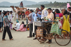 Indian beach (Luke Sergent) Tags: travel sea people food india tourism beach bike photography evening coast stand photo tea drink indian south camel busy traveling buying