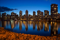 Nights Off The Rocks (Clayton Perry Photoworks) Tags: blue canada skyline night vancouver buildings reflections lights bc falsecreek hirises explorebc explorecanada