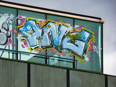 OMG it's ONG (Steve Taylor (Photography)) Tags: city blue newzealand christchurch streetart building art window glass yellow graffiti tag cartoon canterbury nz mauve southisland cbd ong