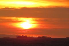 sunshine blues (DOLCEVITALUX) Tags: sunset sea sky sun clouds ships philippines manilabaysunset