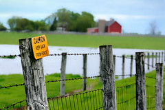 Fear the Fence (Goromo) Tags: sign rural fence spring farm caution barbedwire fermilab floodedfield