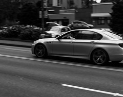 BMW Pan (pillarsoflight) Tags: blackandwhite bw monochrome beauty oregon 35mm portland prime aperture nikon adobe bmw pdx desaturated 18 pnw lightroom d3300