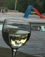 Holiday Cheers (soniaadammurray - SLOWLY TRYING TO CATCH UP) Tags: trees glass pool reflections table wine slide celebrate digitalphotography pavers pooldeck