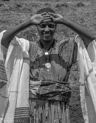 Friendly Sales Woman, Ethiopia (Peraion) Tags: africa blackandwhite woman white black smile face happy towels ethiopia saleswoman