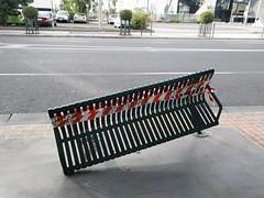 Broke in Thomo (Jennifer Lea) Tags: bench broken thomastown tape red green redtape melbourne chair