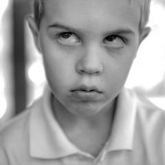 "this summer got me like (listening to ""voodoo child"", jimi hendrix) (jeneksmith) Tags: boy portrait blackandwhite bw cute monochrome face canon grey spring gray april mischief eyeroll"