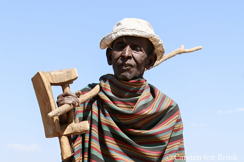 Arbore elder with switch and stool