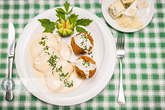 Pork In White Sauce (Cristian Sabau | Photography) Tags: horizontal closeup photography restaurant day sauce nopeople vegetable pork potato barbecue romania transylvania foodanddrink variation cutlery selectivefocus friedpotato whitesauce colorimage greencolor