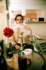 hookah (doctoraine) Tags: friends summer urban white chicago man flower film coffee june youth hair beard table nikon friend warm smoke young culture indoors mug pakistani cigarettes smoker speakers facial tupac hookah kashmiri sheesha sav 400mm vneck