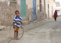 Kid Playing With A Bicycle Tyre, Massawa, Eritrea (Eric Lafforgue) Tags: africa street travel people game men wheel coral horizontal walking outdoors photography town alley day child fulllength citylife 2people twopeople domesticlife ruined massawa eritrea hornofafrica eastafrica realpeople traveldestinations colorimage eritreo buildingexterior erytrea childrenonly eritreia colourimage africanethnicity إريتريا massaoua ertra 厄利垂亞 厄利垂亚 エリトリア eritre eritreja eritréia builtstructure coastalfeature эритрея érythrée africaorientaleitaliana ερυθραία 厄立特里亞 厄立特里亚 에리트레아 eritreë eritrėja еритреја eritreya еритрея erythraía erytreja эрытрэя اريتره אריתריה เอริเทรีย ert6914