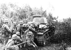 German infantry combat team proceeds behind a Pz Kpfw 35 tank on the outskirts of Leningrad in Sept 1941. Hitler made a conscious decision to invest the city instead of attempting an all-out assault to conquer it. During the 900 days of siege that followed, the Germans never came close to breaking Soviet defenses. The people of Leningrad, however, suffered terribly from hunger, disease, and the shortages of fuel that allowed the Russian winter to destroy hundreds of thousands of civilian lives.