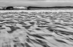 Talisker Bay (movinonagroove) Tags: sea seascape beach canon scotland movement