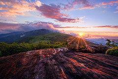 Roan (Michael Bollino) Tags: sunset summer sky sun mountains clouds landscape ancient northcarolina hills ridgeline roan rockoutcrop appalachians sunstar