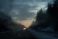 (Frida J) Tags: road blue trees sky snow cold car clouds dark grey evening twilight highway carlights icm carwindow firs vg motorvg waitingfortherain