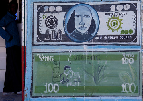 A Painted Advertisement Sign For Money Change Depicting Banknotes, Boorama, Somaliland