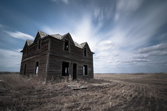 All eyes to the sky. (Fistfulofpowder) Tags: abandoned alberta house field sky grass blue longexposure daytime slowshutterspeed streak streaking streaks windows door wood roof nikond300s tokina1116mm 77mm ndfilter bw 10stop superwide wide wideangle decay decayed decaying urbex urban explorer exploring rangeroad secondaryhighway townshiproad wind nikon raw abandonment destruction weathered beaten dirt skyporn cloudporn settlers tripod slik700dxpro dirtroad yegphotographer