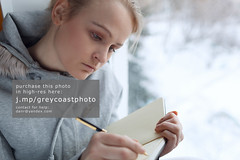 Young girl writing in her journal. (creativemarket.photo) Tags: winter light woman reflection window girl beauty writing notebook book education pretty quiet natural notes diary think gray journal dream young thoughtful dreaming read study sit thinking attractive romantic write homework learn journalism homeschooling clever concentrate