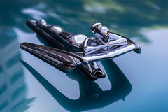 Woman Hood Ornament (HK Passey) Tags: green cars metal silver reflections tire chrome transportation hoodornament automobiles sci vintageautos femalefigure bokehwhores