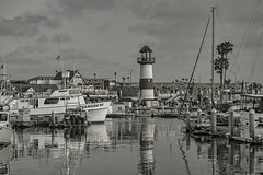Marina Reflections (Y*Y Photography) Tags: ocean bw lighthouse white black reflection water sepia marina boats