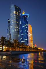Doha from the Corniche (.mushi_king) Tags: sea water lights long exposure fuji dusk explore ramadan notripod doha qatar explored xt10 xf23mm xf23mmf14 fujixt10