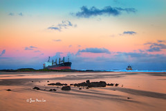 Stranded (stuckinparadise) Tags: stuckinparadise lebouchon mauritius ilemaurice mvbenita ship stranded grounded shipwreck wreck salvage oilleak catastrophe calamity sunset dusk seascape
