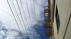 Battery Street is Looking Up, Firescape and Wires Overhead (Lynn Friedman) Tags: sanfrancisco lookingup fireescape 94111 lynnfriedman