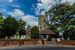 St Mary the Virgin (Ntino Poulak photography) Tags: uk tree church clouds woking cemetary gothic bluesky surrey cloudysky stonebuilding horsell sigma1020mm canon600d