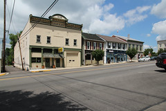 Buildings  Eaton, Ohio (Pythaglio) Tags: county street blue trees windows roof ohio sky signs building cars clouds altered buildings early alley aluminum shingle structures 11 structure historic sidewalk commercial frame shutters eaton block storefronts siding asphalt twostory brackets lugar automobiles preble awnings cornice italianate remodeled pilasters 1888 paneled