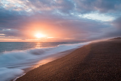 Chesil Beach sunset (kesterfreeman) Tags: longexposure sunset sea sun mist southwest beach clouds waves dorset chesilbeach chesil jurassiccoast