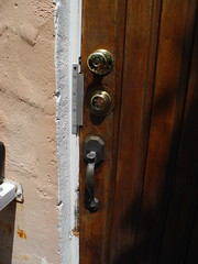 Security is an illusion (My Little Photo Album/Michael Wayne Cole) Tags: door locks doorhandle
