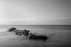 Reef (damo.photo) Tags: sea white black water monochrome out landscape dead still rocks long exposure image horizon calming nobody calm photograph reef relaxed swanage sticking chilled peeping