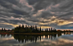 Stormy Sky Over Bud Miller Lake (LostMyHeadache: Absolutely Free *) Tags: trees sky lake storm nature water grass rain weather clouds canon reflections spring atmosphere shore davidsmith lloydminster calgaryalbertacanada budmillerpark eos60d