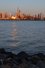 """""""double reflection"""" (light from the setting sun being reflected on the new york city buildings then on the hudson river) - unedited --------- viewed 325x (norlandcruz74) Tags: new york city nyc light sunset usa sun sunlight ny composition america reflections point nikon view state pov perspective may nj cruz empire jersey framing viewpoint pinoy weehawken norland 2013 d5100 norlandcruz74"""
