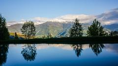 Alpine sunset (anzere03) Tags: mountains alps reflection switzerland pond snowcaps
