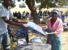 receiving a quilt in Zambia (CLWR1) Tags: kits quilts zambia shipment wecare wecarekits