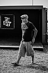 Hot Rod Hooligan (Streetlife) (Mark Kerkhoff; Vagrant Photography) Tags: street camera people bw tattoo 35mm blackwhite nikon zwartwit scheveningen streetphotography fast streetlife denhaag hotrod sideburns thehague straat flatcap d7000 surfdorp hotrodhooligan