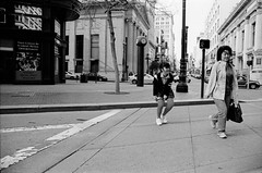 this could be a great retail opportunity (Super G) Tags: strippedsocks retail girl woman candid crosswalk city urban walking streetphotography sanfrancisco bw blackandwhite film fujineopan400 selfdeveloped nikonn80 d7695mins68d11