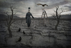 The Magician (Cat Girl 007) Tags: man texture birdcage birds cane photomanipulation digitalart surreal owl deathvalley ladder saltflats magician pocketwatch badwater deadtrees explored vision:outdoor=0948 vision:sky=0793 vision:car=0554 vision:clouds=052