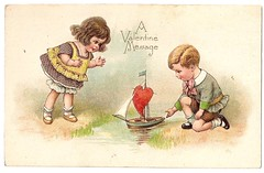 Valentine girl and boy with sailboat (oldsailro) Tags: park old boy sea summer people sun lake playing beach water pool girl sunshine youth sailboat race vintage children fun toy boat miniature wooden pond model waves sailing ship time yacht antique group boom mast hull keel