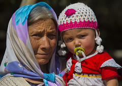 Uyghur Old Woman And Baby, Yecheng, Xinjiang Uyghur Autonomous Region, China (Eric Lafforgue Photography) Tags: china travel portrait people woman baby tourism smiling horizontal scarf outside person kid toddler day child outdoor muslim headscarf chinese uighur xinjiang silkroad oldlady oldwoman daytime uyghur chubby minority 2people twopeople wrinkle anthropology bobble pacifier ethnicity sociology greyhair peoplesrepublicofchina autonomy dayview turkic humanright uygur ouigour seniorwoman lookingatcamera knittedhat twopersons colorpicture headandshoulder ethnicgroup kargilik yecheng colourpicture xinjianguyghurautonomousregion easternandcentralasia turkicethnicgroup dirtypacifier eti1168