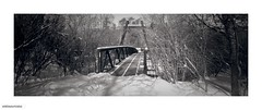 Steel bridge over Don river (DelioTO) Tags: city winter snow toronto ontario canada landscape blackwhite woods trails panoramic february 90mm tmax100 schneider tmaxdev 6x17 lensed autaut