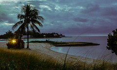 Early Morning Beach Cleaner (Denzil D) Tags: ocean tractor beach canon sand florida machinery palmtrees atlanticocean scraper floridakeys beachcombing beachlovers earlymorninglight suntanners canoneosrebelt2i