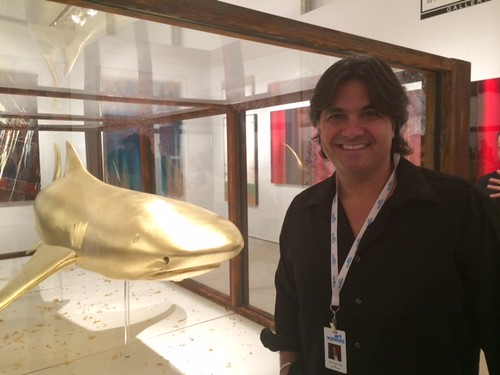 Hamilton Aguilar, artist and owner of Wynwood Art group(A1), with his shark at the VIP opening of art Wynwood