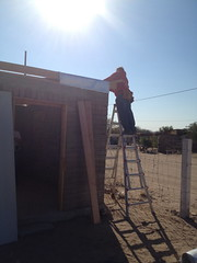 John installs the roof