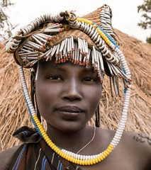 Mursi Woman, Ethiopia (Rod Waddington) Tags: africa portrait people woman female beads costume outdoor african traditional tribal hut afrika omovalley ethiopia tribe ethnic mago mursi ethnicity afrique ethiopian omo thiopien etiopia ethiopie etiopian omoriver