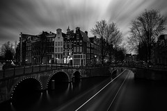 Black and White City Lights (angheloflores) Tags: longexposure travel bridge houses sunset sky urban netherlands colors amsterdam architecture night clouds reflections lights canal cityscape explore keizersgracht
